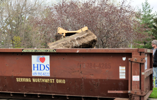 It was a struggle, but this huge chunk of concrete made it safely into the container.