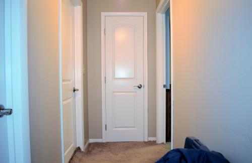 White Roman-style doors brighten the house.