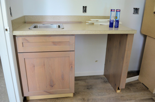 Counter and sink in laundry room.