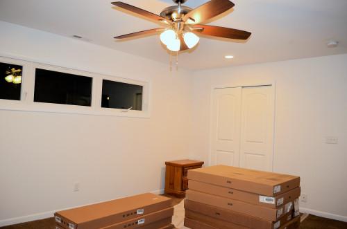 Bedroom progress: carpet closet doors, HVAC registers, recessed lights.