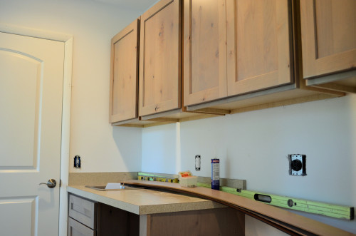 Cabinets in laundry room.