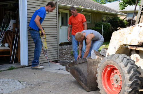 The concrete guys working hard to remove the old front walk.