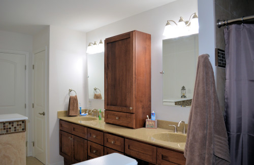 Double vanity with storage tower.