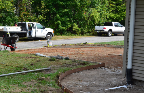The old concrete has been removed from the driveway and a grid of rebar added.